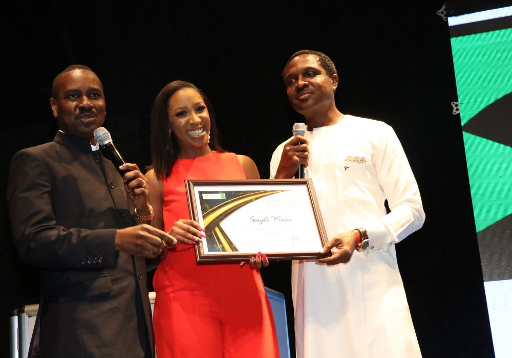 Pastor Ituah Ighodalo and Tonye Cole presenting the award to Georgette Monnou, winner of the Creative Writing and Content Creation category.