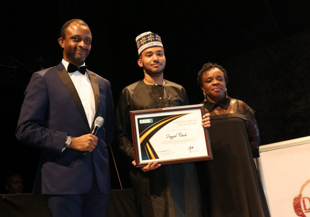 Thompson Reuters West Africa Business Manager, Chuba Ogbue and Deputy Country Head at Deutsche Bank Nigeria, Adeola Azeez presenting the award to the Social Entrepreneurship Category winner, Zayyad Nasidi.